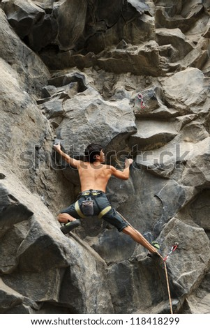 rock climber searching for a