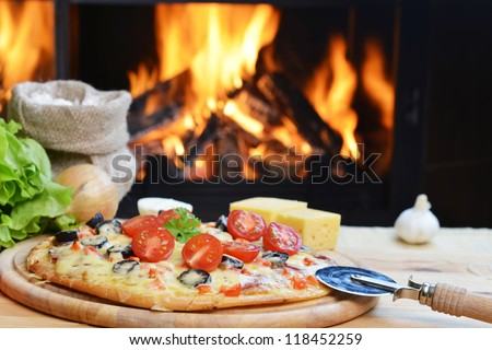 baked tasty pizza  near wood