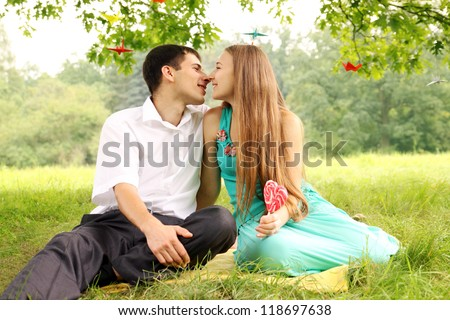 man and woman kissing under a