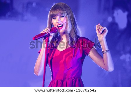 taylor swift performs and turns