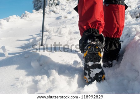 hiker in a winter mountain
