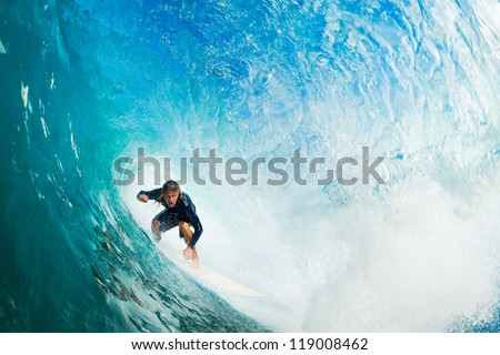 surfer on blue ocean wave in