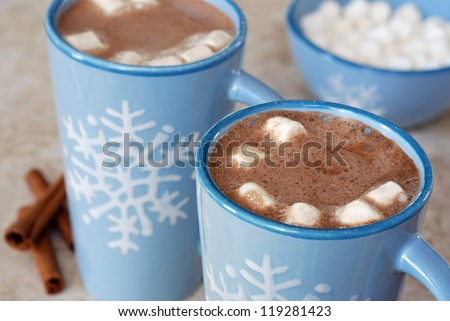snowflake mugs filled with hot