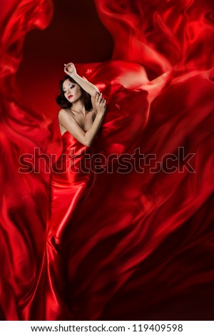 woman in red dress dancing