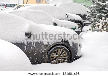 cityscape   parked cars covered