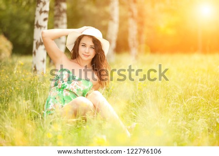 young redhead woman in the park
