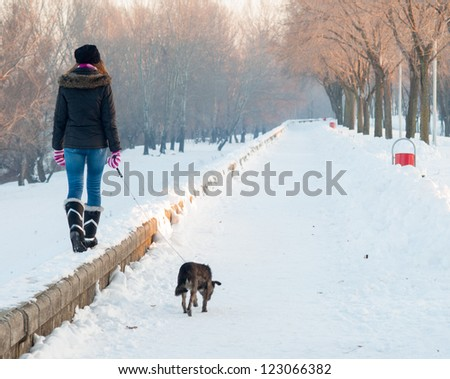 teenage girl walks the dog on