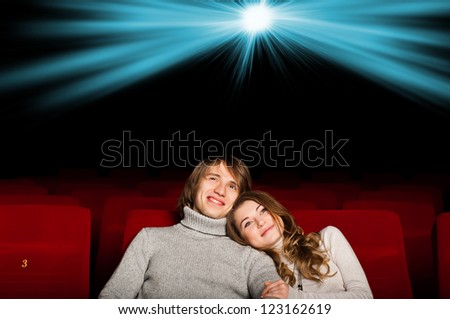 young couple in the cinema to