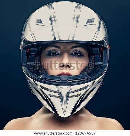 sexy woman in helmet on dark