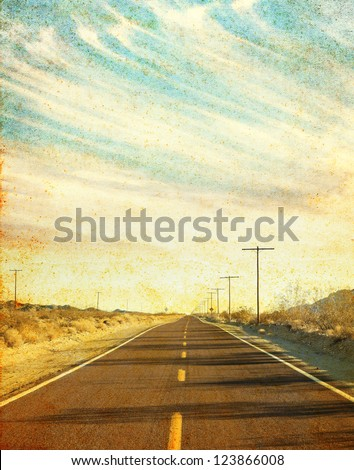 an empty desert road in arizona'