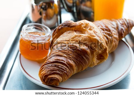 fresh croissant on table