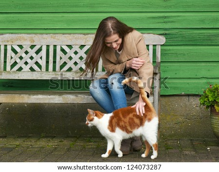 cute girl petting a furry cat