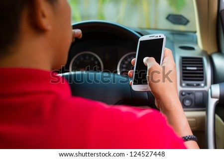 asian man sitting in car with