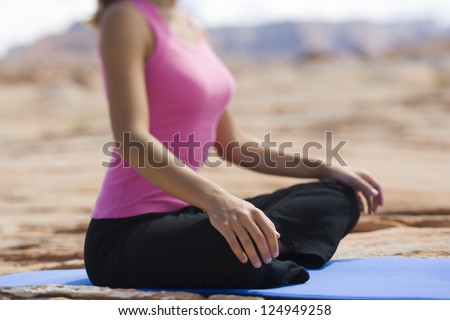 body of young woman meditating