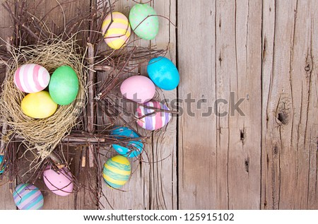 easter eggs in nest on rustic
