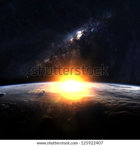 earth with rising sun in space