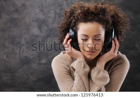 young beautiful woman listening