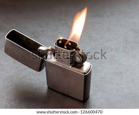 silver metal lighter on black