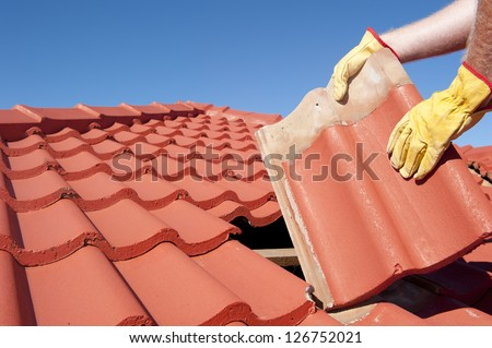 roof repairs  worker with