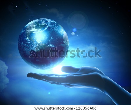 image of hand holding earth