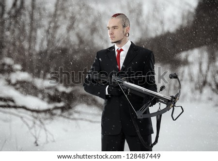 hitman with a crossbow in an