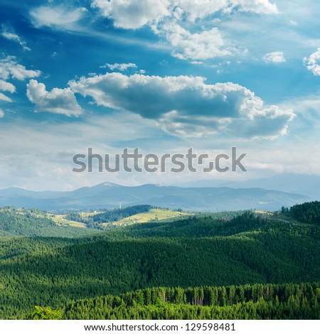 green mountain covered by