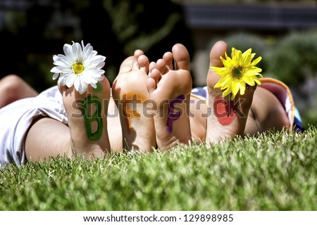 young girls laying in the grass