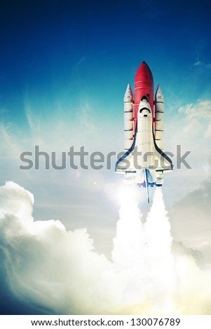 space shuttle taking off on a