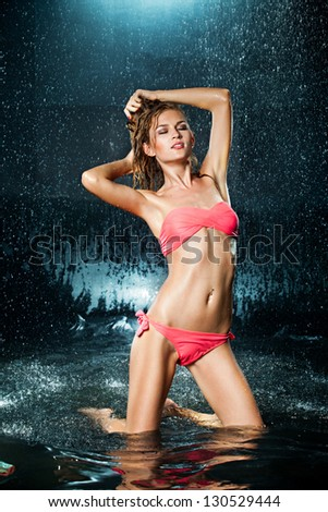 young sexy woman water studio