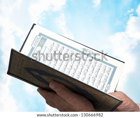 muslim male hands with quran