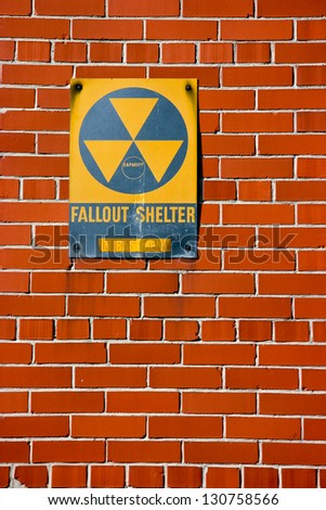 fallout shelter sign on a brick