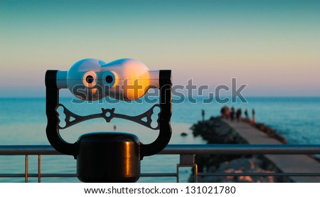 binoculars on the sea of grado