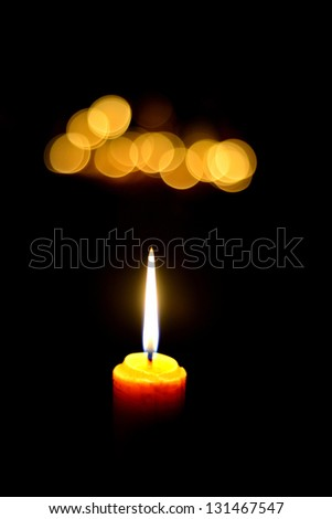 one candle flame at night with