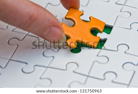 hands placing last piece of a