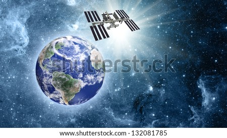 space station over blue planet