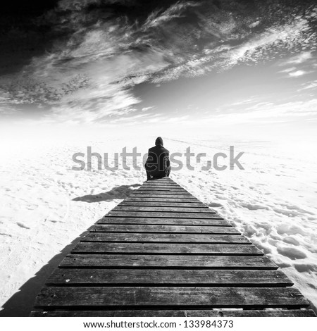 man sit on old wooden pier