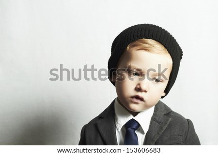 sad little boy in suitstyle