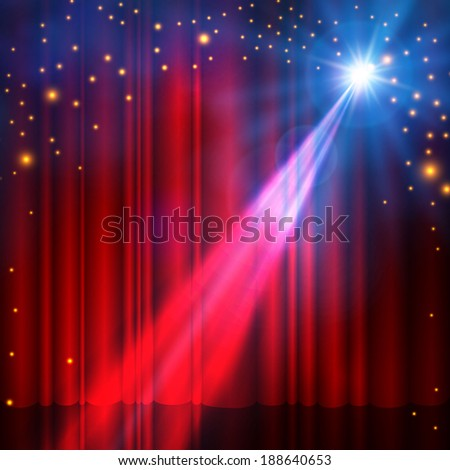spotlight on red stage curtain