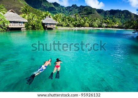 young couple snorkeling in