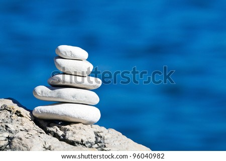 white pebbles stack and blue