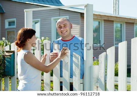 young woman and man near fence
