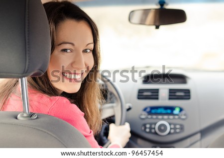 woman sitting in car getting