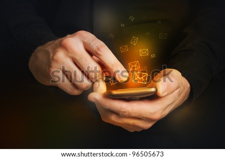 man typing text message on