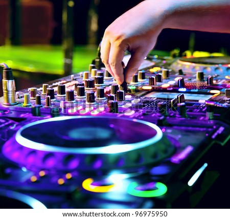 dj mixes the track in nightclub