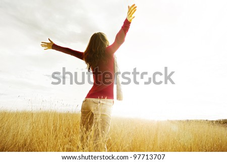 young girl spreading hands with