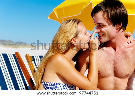 summer beach couple take care
