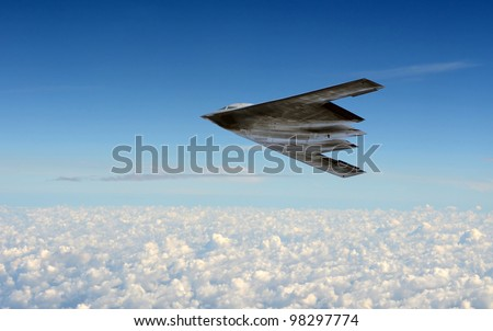 modern stealth bomber flying at