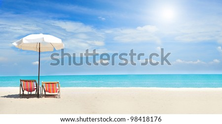 beach chairs on the white sand