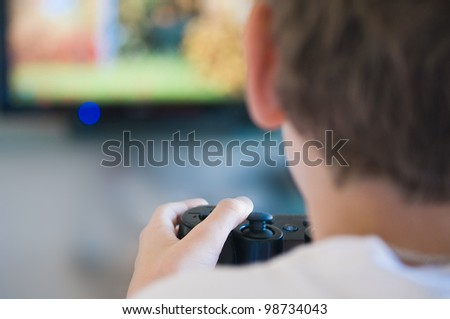 boy with joystick playing