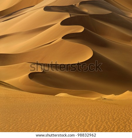 sand dunes at sunset in the